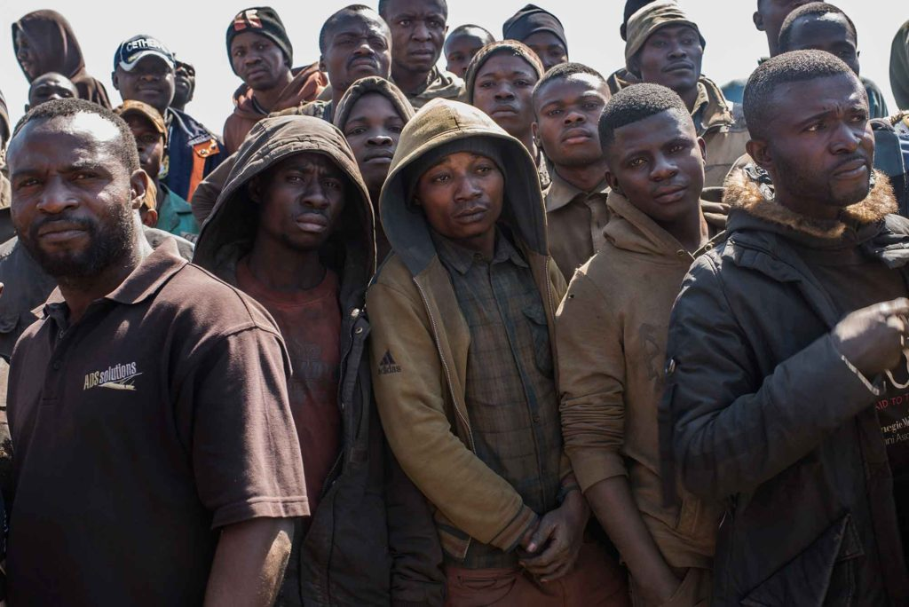 "TILWEZEMBE, DEMOCRATIC REPUBLIC OF CONGO - JUNE 9 ""Creuseurs,"" or diggers gather at the Dilwa cobalt mine outside of Kolwezi on June 9, 2016. Miners and workers make on average, US$2-3/day for their labor and work in dangerous conditions with no safety equipment and often, no shoes. The cobalt is separated and then sold to ""comptoirs,"" or counters at a marketplace and then shipped to local factories of Congo Dongfang International Mining(CDM). Cobalt is used in batteries for electronic cars and mobile phones and the DRC has roughly 65 percent of the world's supply. (Michael Robinson Chavez/The Washington Post)"